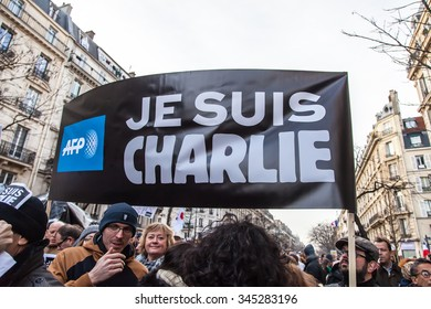 "Paris, France - January 11, 2015: People with ""Je suis Charlie"" during anti-terrorism rally in Paris"