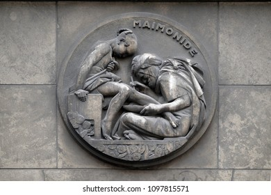 PARIS, FRANCE - JANUARY 11, 2018: Maimonides, the real name of Mose ben Maimon, the Jewish philosopher, theologian and physician. Stone relief at the building of the Faculte de Medicine Paris.