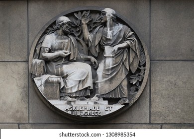 PARIS, FRANCE - JANUARY 11: Asclepiade and Lucrece, Greek medicine in Rome. Stone relief at the building of the Faculte de Medicine Paris, France on January 11, 2018.