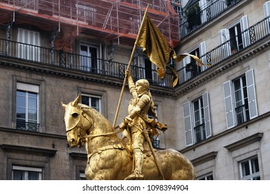 PARIS, FRANCE - JANUARY 11: Golden statue of Joan of Arc on horseback in Paris near Louvre Museum in Paris, on January 11, 2018.