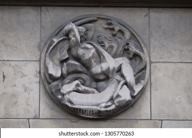 PARIS, FRANCE - JANUARY 11: Heracles and Hydra. Stone relief at the building of the Faculte de Medicine Paris, France on January 11, 2018.