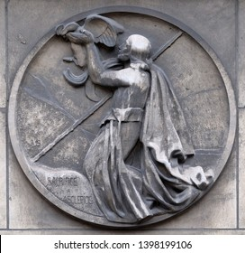 PARIS, FRANCE - JANUARY 11: Sacrifice to Asclepius, god of medicine in ancient Greek religion and mythology. Stone relief at the building of the Faculte de Medicine Paris, France on January 11, 2018.