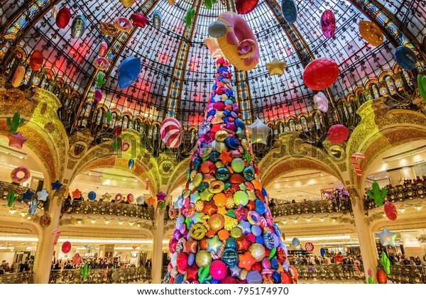 PARIS, FRANCE - JANUARY 13, 2018: The Christmas tree at Galeries Lafayette. Galeries Lafayette is an upmarket French department store chain that has been selling luxury goods since 1895.
