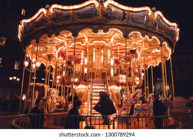 PARIS, FRANCE - JANUARY 2, 2012: Iilluminated carousel in Paris, France, at night