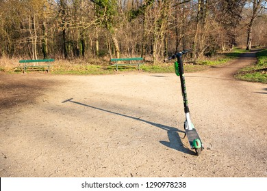 PARIS, FRANCE - JANUARY 21, 2019:  Electric scooter dropped near Vincennes forest of Paris. In Paris scooter-sharing system service for short-term rentals hire  operated by Bird, Bolt, Lime and Wind.