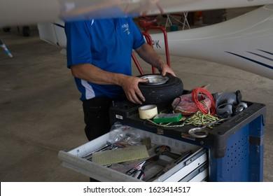PARIS, FRANCE - JANUARY 21, 2020: Microlight Ultralight aircraft changing flat tire