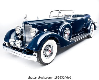 Paris, France- January 21, 2021: A blue Packard Twelve Convertible Victoria of 1934 is parked in showroom