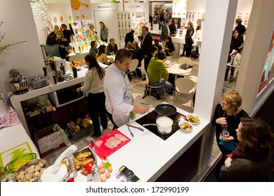PARIS, FRANCE - JANUARY 24, 2014: A chef makes a cooking demo on a stand at Maison&Objet, the French leading professional trade show for home fashion in Paris, France.