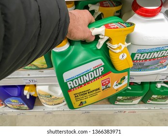 Paris, France - January 25, 2019: Customer buying roundup in a french Hypermarket. Roundup is a brand-name of an herbicide containing glyphosate, made by Monsanto Company.