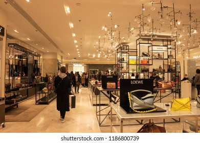 PARIS, FRANCE - JANUARY 27, 2018: People in shopping in Printemps department store. Loewe and Chanel boutiques.