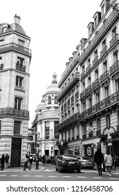 PARIS, FRANCE - JANUARY 27, 2018: Urban scene in Parisian shopping city centre near Boulevard Haussmann with view of C&A shop and Printemps department store building. Black and white photo.