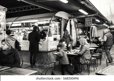 """PARIS, FRANCE - JANUARY 28, 2017: People eat at Marche des Enfants Rouges (""""Red Children Market """"). This oldest covered market in Paris is known for its fresh produce and a variety of food stalls."""