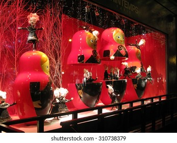 PARIS, FRANCE - JANUARY 3, 2010: Christmas window decorations beautifully lit at night in the Printemps department store on January 3, 2010 in Paris, France.