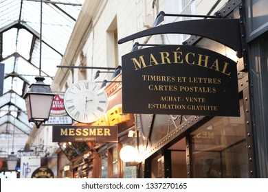 Paris / France - January 31, 2016: hidden street with a roof called covered gallery. Small vintage restaurants, old boutiques, local shops. Ancient signboards and vitrines. Glass roof
