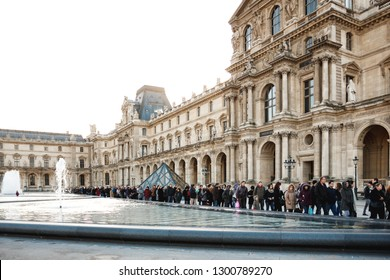 PARIS, FRANCE - JANUARY 4, 2012: People waiting in a queue to visit the Louvre Museum