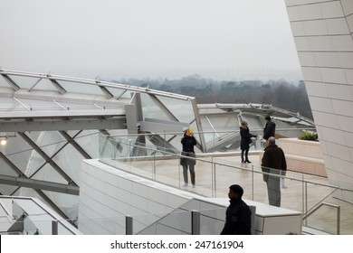 PARIS, FRANCE - JANUARY 5, 2015: Tourists visiting the Fondation Louis Vuitton arts center