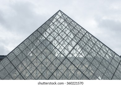 PARIS, FRANCE - January 7, 2011: The large glass pyramid and the main courtyard of the Louvre Museum . The Louvre Museum is one of the largest museums of the world
