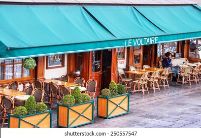 Paris, France - January 9, 2015. Traditional parisian cafe. Cafe le Voltaire named after the french writer Voltaire. It contained in the house, where  Voltaire lived. Travel, cuisine concept. France.