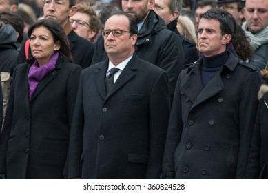PARIS, FRANCE - JANUARY,10, 2016 : Anne Hidalgo, Francois Hollande and Manuel Valls at Place de la Republique to pay tribute to victims of the terrorists attacks of 2015, Charlie Hebdo and Bataclan.