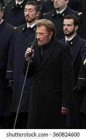 PARIS, FRANCE - JANUARY,10, 2016 :  Singer Johnny Hallyday at Place de la Republique singing to pay tribute to victims of the terrorists attacks of Charlie Hebdo and Bataclan.