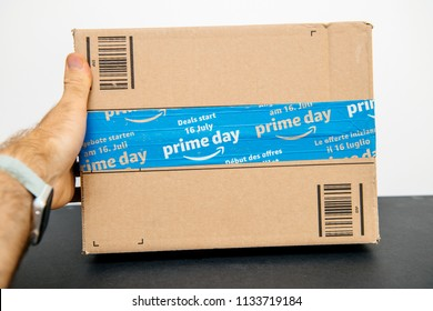 PARIS, FRANCE - JUL 12, 2108: Amazon Prime Day cardboard parcel with special blue scotch tape for the Prime Day offering a day of deals, discounts, and unabashed shopping