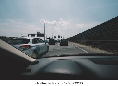 Paris, France - Jul 15, 2018: Driver POV personal perspective and the front driving Renault car in traffic jam exiting lane of Boulevard peripherique in Paris, France - cinematic vintage filter