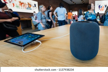 PARIS, FRANCE - JUL 16, 2018: People in Apple Store and the latest Apple Computers HomePod smart speaker with Siri and Apple Music