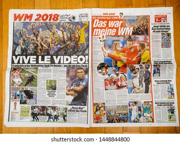 PARIS, FRANCE - JUL 16, 2018: Man reading Die Bild German newspaper announcing France champion title after French national football team won their FIFA World Cup 2018 final game against Croatia in