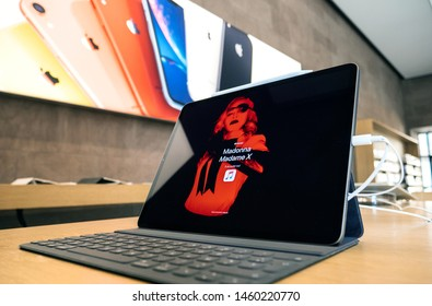 Paris, France - Jul 24, 2019: New modern Apple Store with advertising on the new iPad Pro tablet display for the latest Madonna Album and message to listen to Madame X on Apple Music