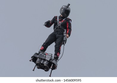PARIS, FRANCE Jully 14th 2019 : Franky Zapata flies with his own creation, a jet powered flyboard during the traditional military parade for the bastille day in front of the presidential platform.