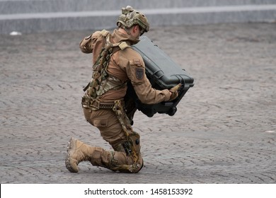 PARIS, FRANCE Jully 14th 2019 :  Soldier from french task forces uses Mawashi exoskeletons to lift a heavy load in front of the presidential platform during the Bastille day military parade.