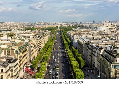 Paris, France - July 01, 2017: Aerial view of Paris cityscape with Avenue des Champs-Elysees from the top of Triumphal Arch of the Star (Arc de Triomphe de l'Etoile) at the summer sunset.