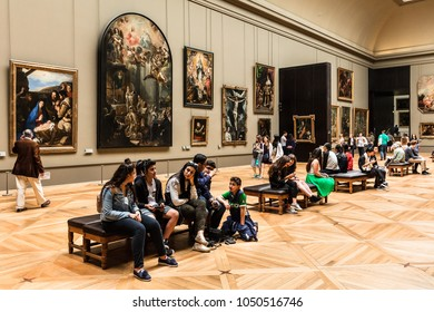 Paris, France - July 01, 2017: Tourists visit art gallery in the Louvre Museum. The Louvre Museum is one of the largest and most visited museums worldwide.