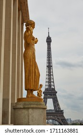 Paris / France - July 02 2013: View of the Eiffel Tower and golden sculpture the Musée de l'Homme is an anthropology museum in Paris