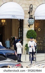 Paris, France - July 02, 2016: Doormen with uniform meet tourists at the entrance to the Ritz Paris hotel in the heart of Paris on Place Vendome.