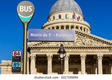 Paris, France - July 03, 2017: Pantheon bus stop sign with the Pantheon in the background in the summer. The Pantheon is a secular mausoleum containing the remains of distinguished French citizens.