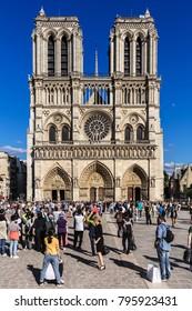 Paris, France - July 03, 2017: Tourists visiting the Notre Dame de Paris Cathedral on the Cite Island. Notre-Dame Cathedral  is a medieval catholic cathedral.