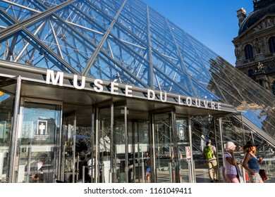 Paris, France - July 04, 2018: Entrance to the Pyramid of the Louvre Museum