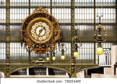 Paris, France - July 05, 2017: Golden clock in the Orsay Museum. The Musee d'Orsay is a museum in Paris, on the left bank of the river Seine.