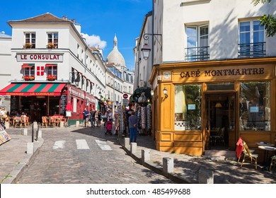 Paris, France - July 06, 2016: The charming quarter of Montmartre hill near basilica Sacre Coeur with traditional french cafes and art galleries