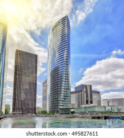 PARIS, FRANCE - JULY 06, 2016 :La Defense, Business Quarter with businessmen in the streets, area of Paris,  French financial center with skyscrapers and modern buildings.