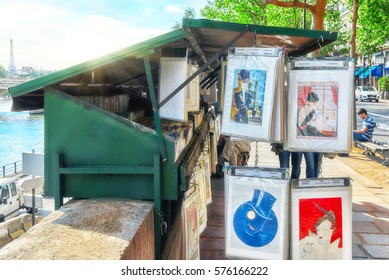 PARIS, FRANCE - JULY 06, 2016 : Street artists on the River Seine in most beautiful cities in the world-Paris. People look works of art. Paris.