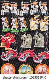 Paris, France - July 06, 2017: Various souvenir magnets with the symbols of Paris are laid out on a counter of the small street gift shop. The magnet is one of the most popular souvenirs from Paris.