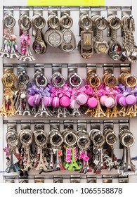 Paris, France - July 06, 2017: Various souvenir keychains with the symbols of Paris are laid out on a counter of the street gift shop. The key ring is one of the most popular souvenirs from Paris.