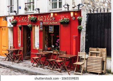 Paris, France - July 06, 2017: The charming restaurant Chez Marie on Montmartre hill. Montmartre with traditional french cafes and art galleries is one of the most visited landmarks in Paris.