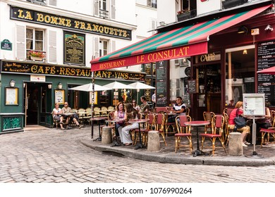 Paris, France - July 06, 2017: The charming restaurant Le Consulat on the Montmartre hill. Parisians and tourists enjoy food and drinks.