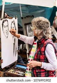 Paris, France - July 06, 2017: The painter works at the open air artist market at the Tertre Square (Place du Tertre) in the Montmartre district.