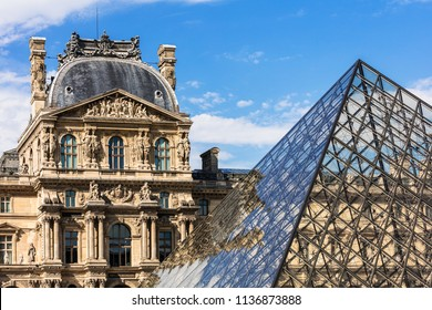 Paris, France - July 06, 2017: Fragments of the Louvre Palace and the Pyramid. The Louvre Museum (Musee du Louvre) is the world's largest art museum and a historic monument in Paris.