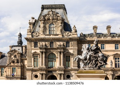 Paris, France - July 06, 2017: Fragments of the Louvre Palace. The Louvre Museum (Musee du Louvre) is the world's largest art museum and a historic monument in Paris. Paris, France