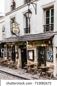 Paris, France - July 06, 2017: The charming cafe La Taverne de Montmartre on Montmartre hill. Montmartre with traditional french cafes and art galleries is one of the most visited landmarks in Paris.